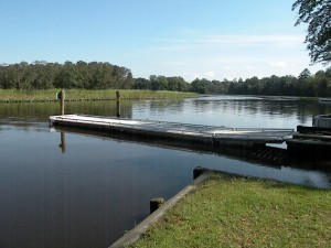 Floating dock between two boat ramps